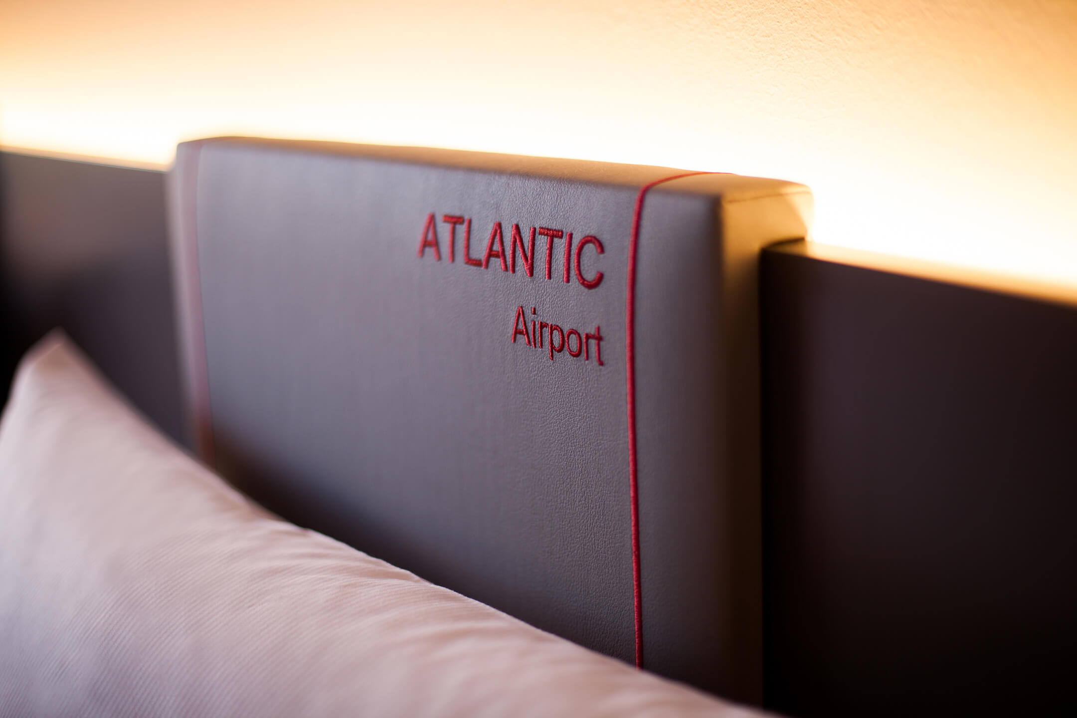 Logotype of the ATLANTIC Hotel Airport at the bed