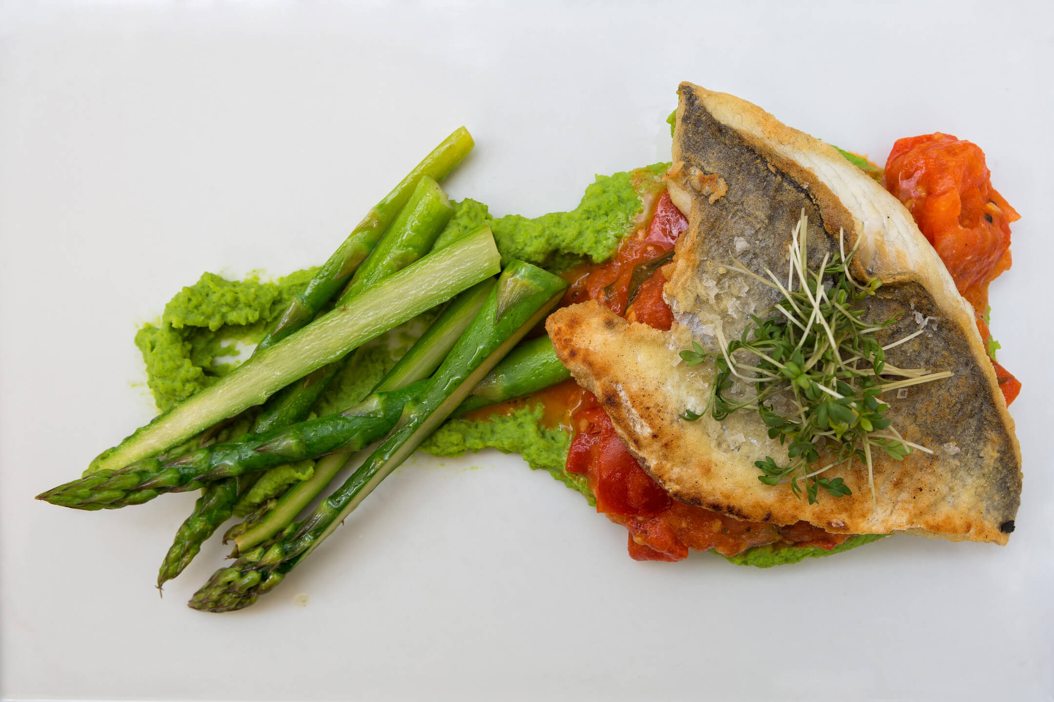 served plate with asparagus and fish
