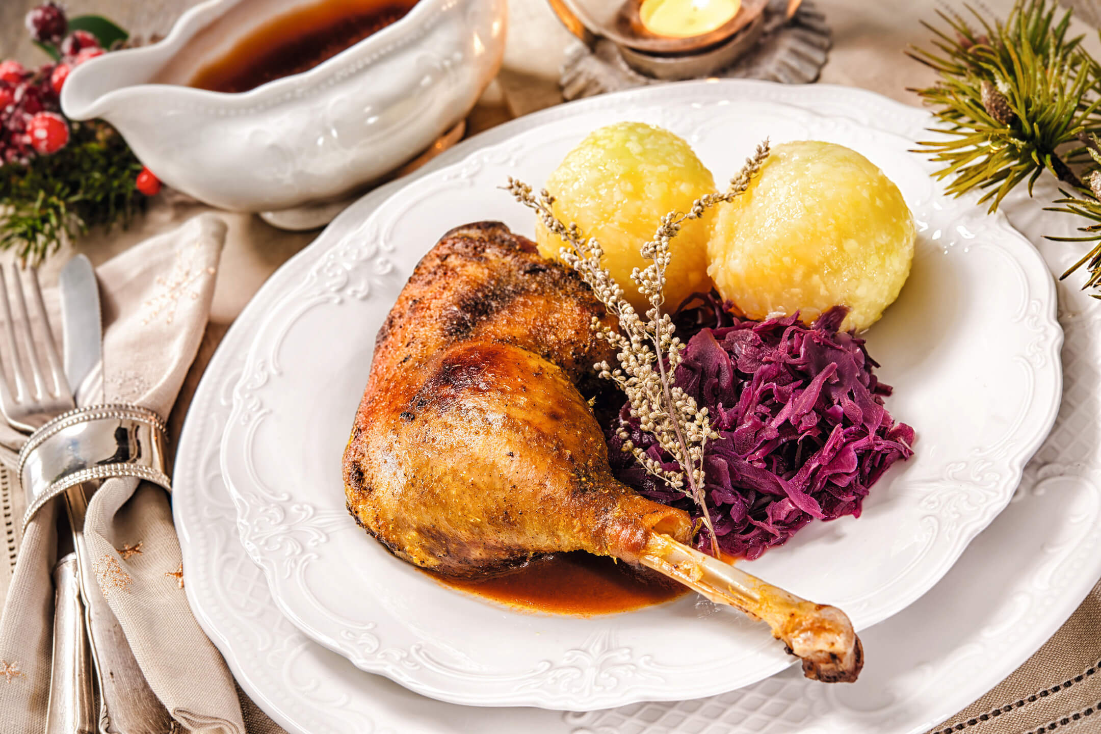 goose leg with dumpling and red cabbage