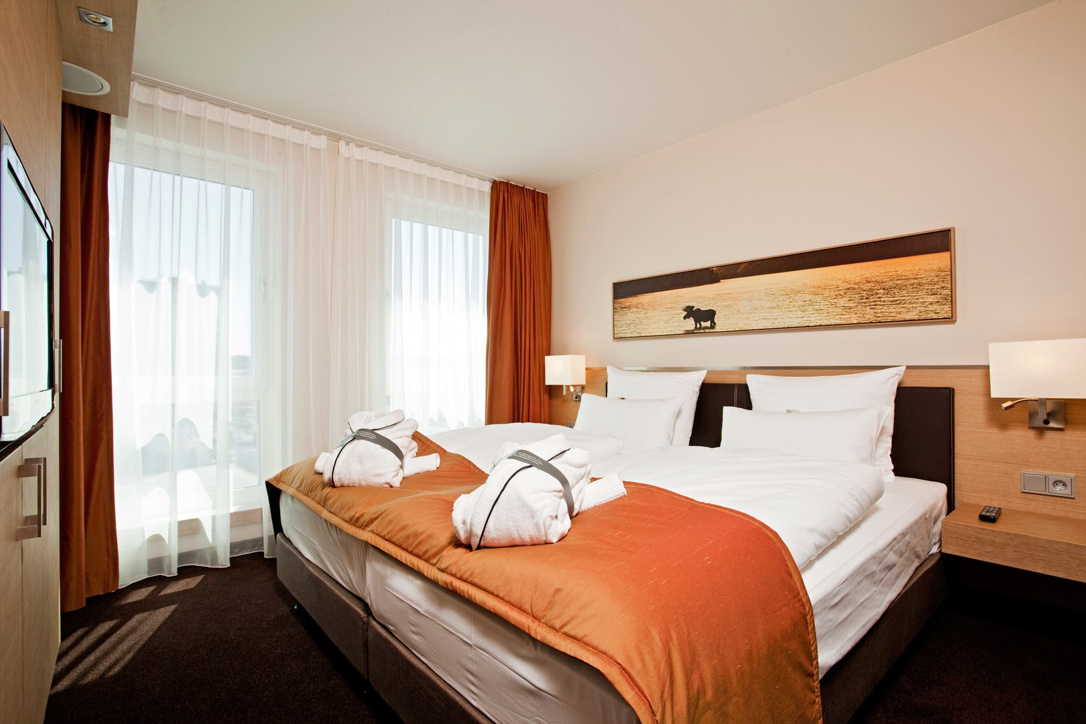 Interior view of the Suite in the ATLANTIC Hotel Kiel with double bed and luxourious furniture