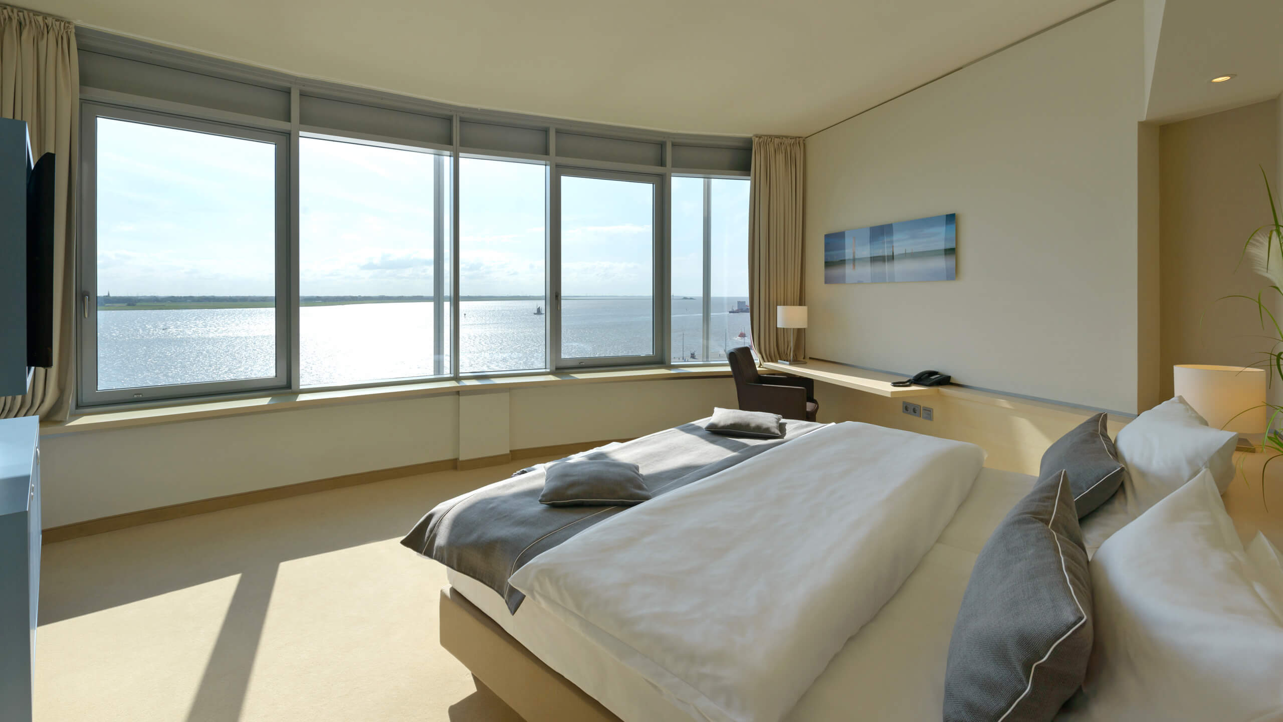 Interior view of a Suite in the ATLANTIC Hotel SAIL City in Bremerhaven with an amazing view over the Weser