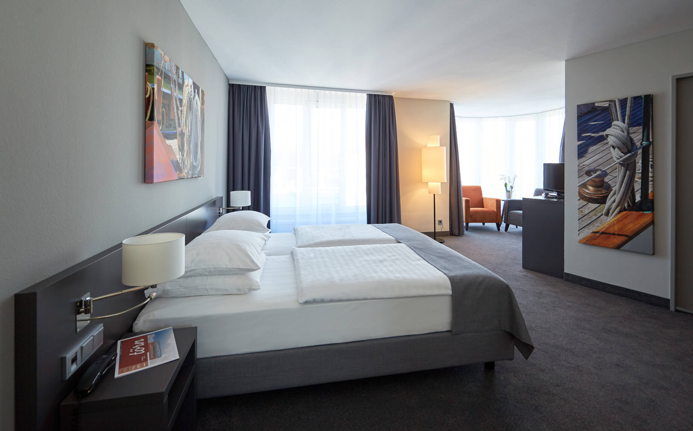 Interior view of the generously furnished Studio in the ATLANTIC Hotel Vegesack in Bremen