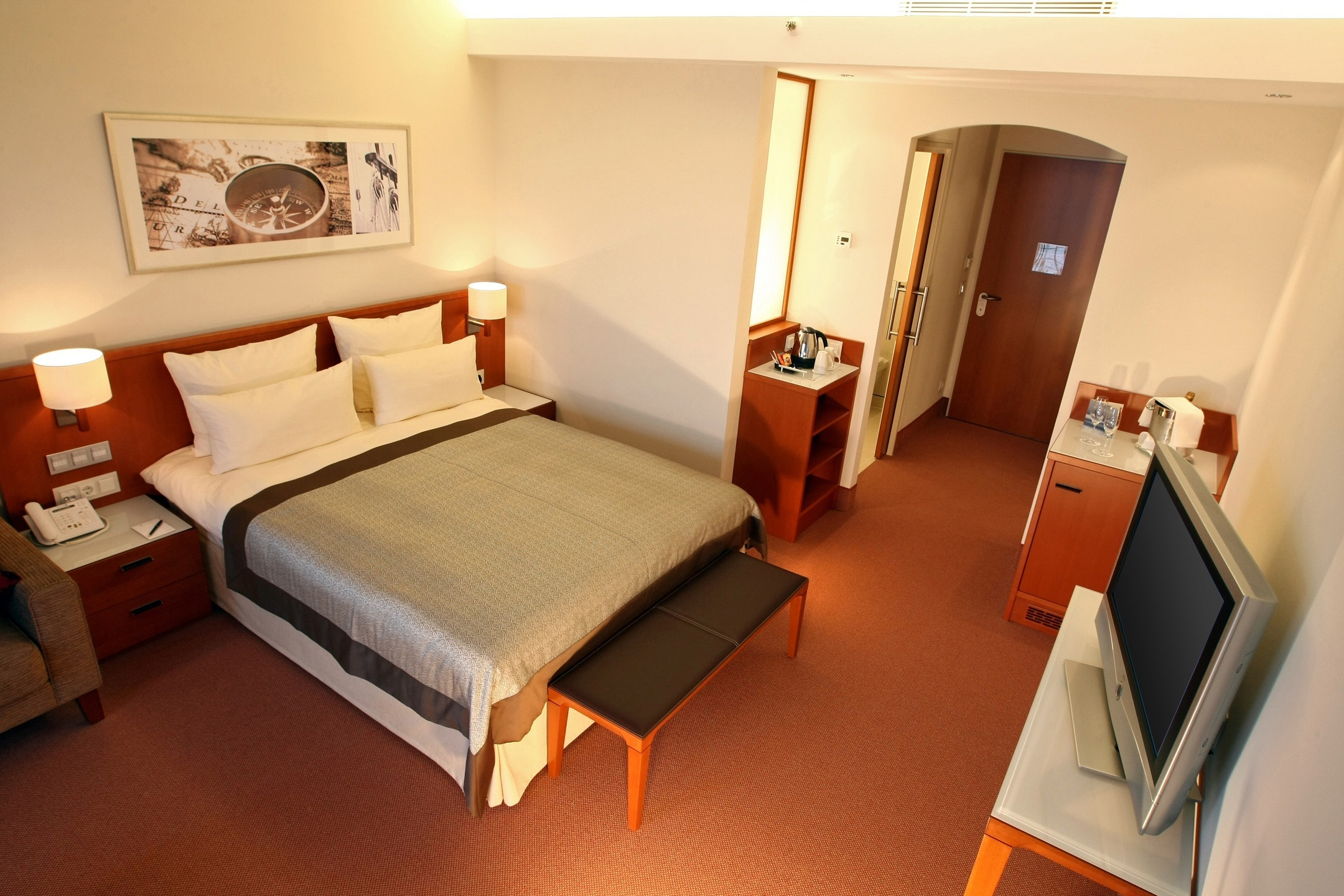Bedroom with a big bed in the ATLANTIC Hotel Wilhelmshaven