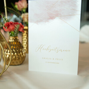 withe-blush colored menu on laid table