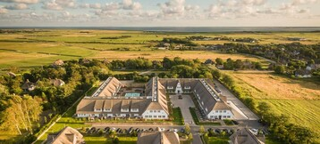 Terrain top view of the grounds of the Hotel Severin*s Resort & Spa and the Sylt coast by drone