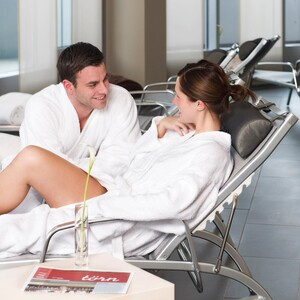 Couple in the Wellness area of the ATLANTIC Hotel SAIL City in Bremerhaven